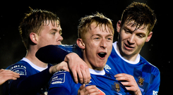 Waterford's Dean O'Halloran celebrates with team-mates Gary Comerford, left, and Rory Feely, right, after scoring his side's second goal. Photo: Diarmuid Greene/Sportsfile