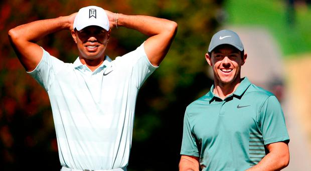 Tiger Woods and Rory McIlroy wait to tee off at the fourth hole. Photo: Christian Petersen/Getty Images