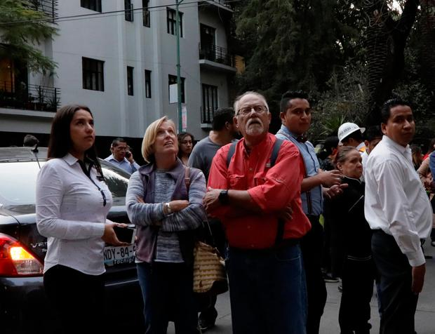 People react on a street after a tremor was felt in Mexico City, Mexico February 16, 2018. REUTERS/Henry Romero