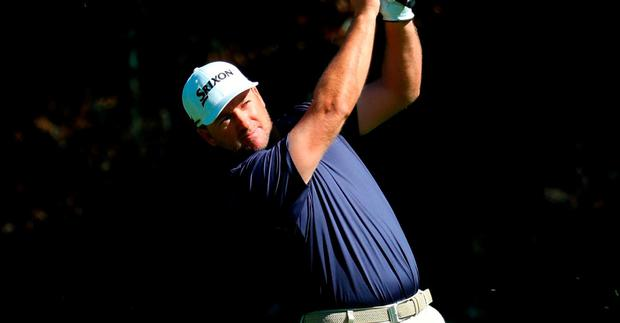Graeme McDowell of Northern Ireland plays his shot on the 12th hole during the second round of the Genesis Open at Riviera Country Club
