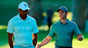 Tiger Woods and Rory McIlroy of Northern Ireland walk across the 17th hole during the second round of the Genesis Open at Riviera Country Club on February 16, 2018 in Pacific Palisades, California. (Photo by Warren Little/Getty Images)