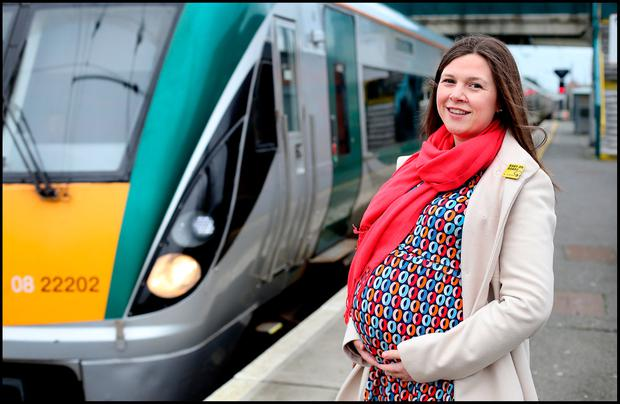 Chrissie Russell sitting on a DART with her 'Baby On Board' pin. Picture: Steve Humphreys