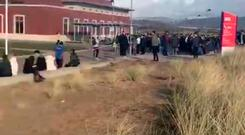 Screen grab taken with permission from a video posted on Twitter by @SweetlyShan of Swansea University Bay Campus being evacuated after an earthquake shook parts of the UK. Photo: @SweetlyShan/PA Wire
