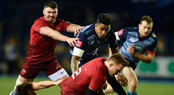 17 February 2018; Rory Scannell of Munster is tackled by Jarrod Evans of Cardiff Blues during the Guinness PRO14 Round 15 match between Cardiff Blues and Munster at Cardiff Arms Park in Cardiff. Photo by Ben Evans/Sportsfile