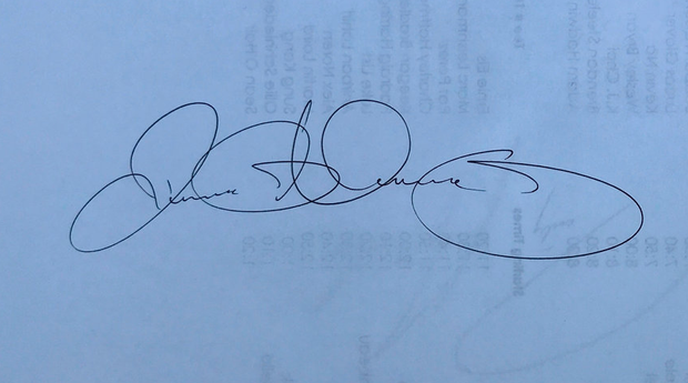 Rory McIlroy's signature — apparently there is a correlation between the size of the initials and the author's ego, suggesting that Harrington has a bigger ego than McIlroy.