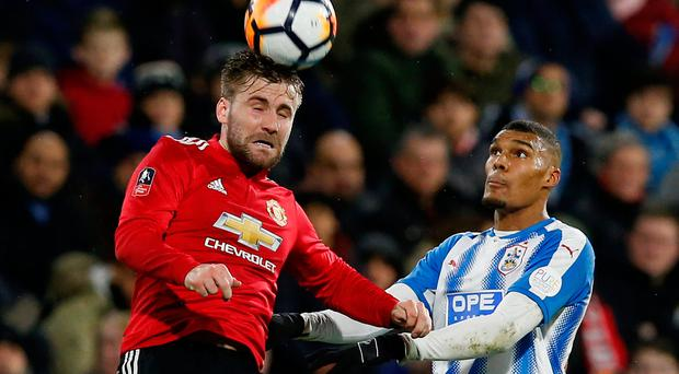 Manchester United defender Luke Shaw rises above Huddersfield Town's Collin Quaner in his side's 2-0 FA Cup fifth-round victory at John Smith's Stadium yesterday. Photo: Reuters