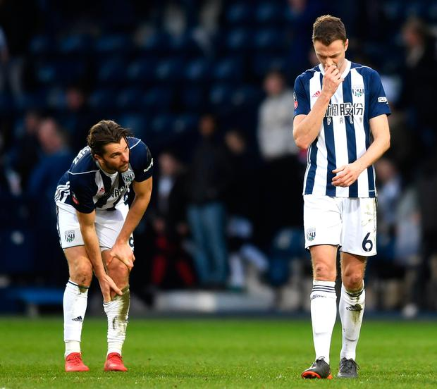 Jay Rodriguez and Jonny Evans of West Bromwich Albion look dejected. Photo: Getty Images