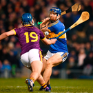 Tipperary's Jason Forde scores his side's second goal despite the attention of Conor Firman. Photo: Stephen McCarthy/Sportsfile