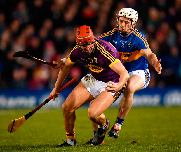 Wexford's Paul Morris in action against Sean O'Brien of Tipperary. Photo: Stephen McCarthy/Sportsfile