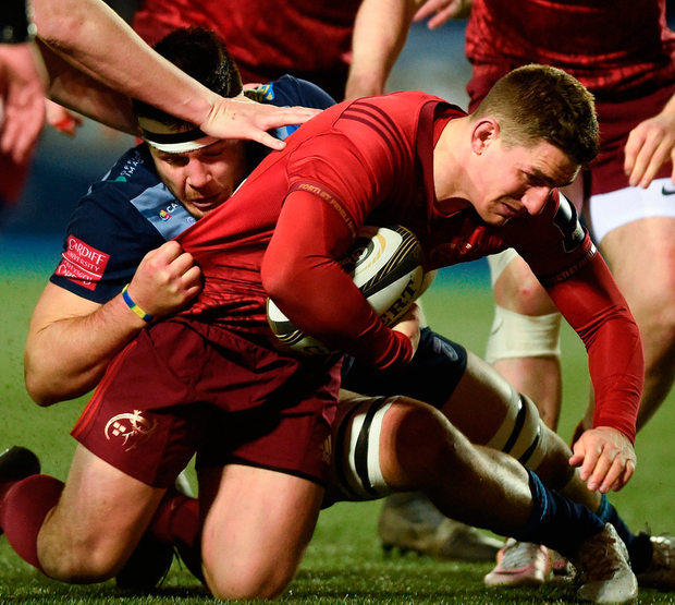 Munster's Ian Keatley is tackled by Ellis Jenkins of Cardiff Blues. Photo: Ben Evans/Sportsfile