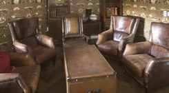 Leather chairs, bookshelves and trunk tables from Residence