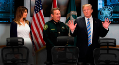 Gun control — The elephant in the room: Donald and Melania Trump speak with Broward County Sheriff Scott Israel while visiting the Sheriff's Office in Pompano Beach, Florida, last Friday — three days after a mass shooting that claimed 17 lives at a nearby school. Photo: Getty Images