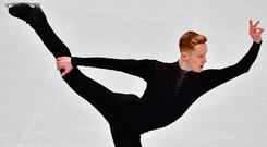 Ireland's Conor Stakelum performs his routine in the men's short program at the ISU European Figure Skating Championships in Moscow on January 17, 2018. / AFP PHOTO / Mladen ANTONOV