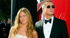 Jennifer Aniston and husband Brad Pitt attend the 56th Annual Primetime Emmy Awards at the Shrine Auditorium September 19, 2004 in Los Angeles, California. (Photo by Kevin Winter/Getty Images)