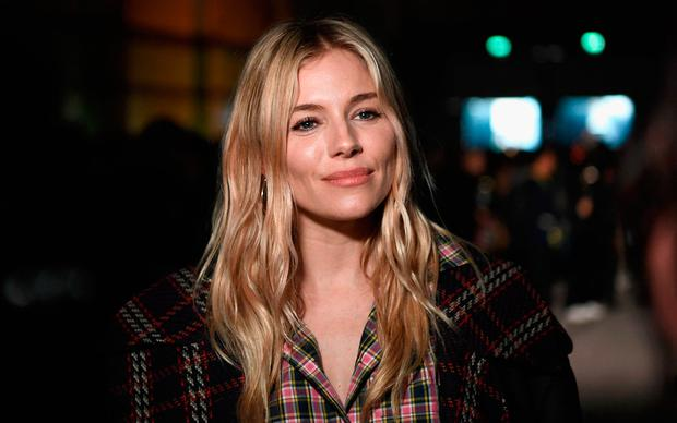 Sienna Miller at the Burberry February 2018 show during London Fashion Week at Dimco Buildings on February 17, 2018 in London, England. (Photo by Gareth Cattermole/Getty Images for Burberry)