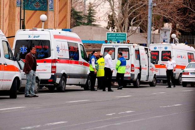 Iranian emergency services gather in front of a mosque near Tehran's Mehrabad airport on February 18, 2018. All 66 people on board an Iranian passenger plane were feared dead after it crashed into the country's Zagros mountains, with emergency services struggling to locate the wreckage in blizzard conditions. / AFP PHOTO / ATTA KENAREATTA KENARE/AFP/Getty Images