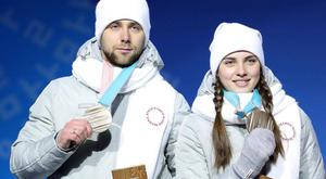 Aleksandr Krushelnitckii and his wife Anastasia Bryzgalova collect their bronze medals. Getty Images