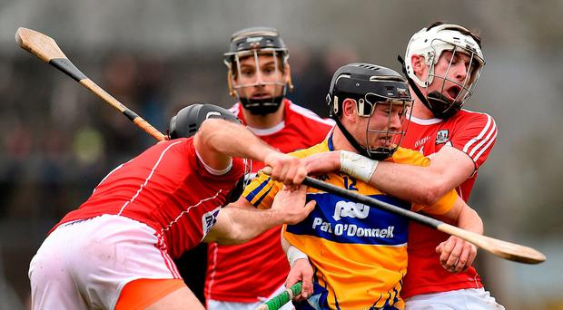 David Reidy of Clare in action against Christopher Joyce, left, and Colm Spillane of Cork during the Allianz Hurling League Division 1A Round 3 match between Clare and Cork at Cusack Park in Ennis, Clare. Photo by Seb Daly/Sportsfile