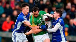 Graham Reilly of Meath in action against Dara McVeety, left, and Niall Murray of Cavan during the Allianz Football League Division 2 Round 3 Refixture match between Cavan and Meath at Kingspan Breffni in Cavan. Photo by Philip Fitzpatrick/Sportsfile