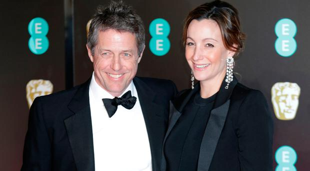 Hugh Grant and Anna Eberstein attending the EE British Academy Film Awards held at the Royal Albert Hall, Kensington Gore, Kensington, London. PRESS ASSOCIATION Photo. Picture date: Sunday February 18, 2018. See PA Story SHOWBIZ Bafta. Photo credit should read: Yui Mok/PA Wire.