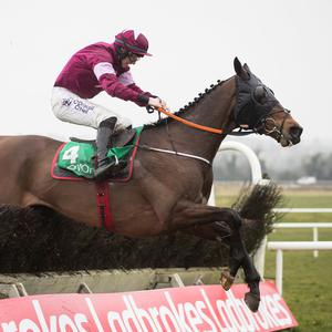 Monbeg Notorious, with Jack Kennedy up, on the way to winning the Ten Up Novice Chase at Navan yesterday. Photo: Patrick McCann