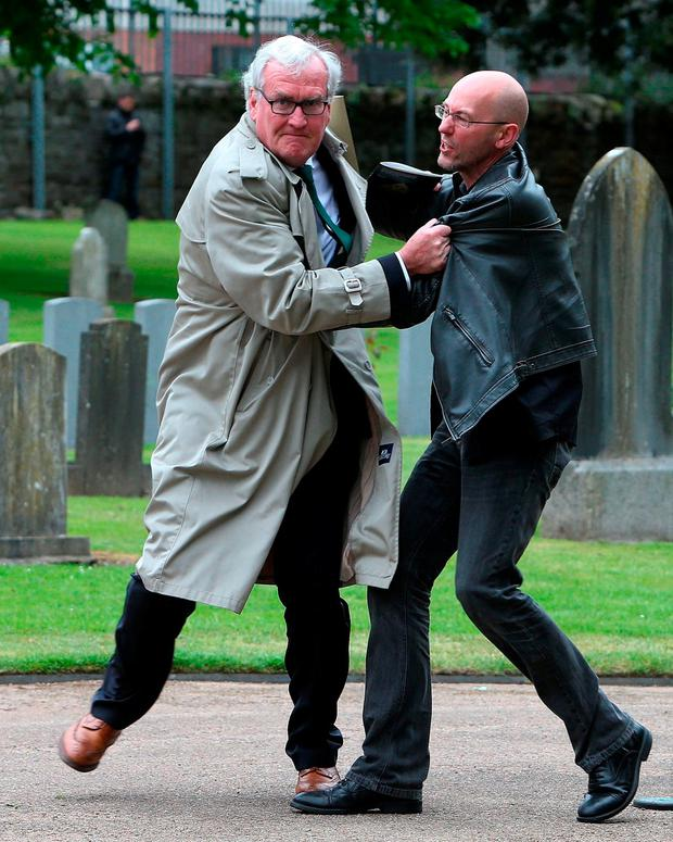 Vickers wrestles with a protester during a State ceremony in Grangegorman Military Ceremony in 2016 to remember the Irish soldiers who died while fighting for the British Army during the Easter Rising. Photo: PA