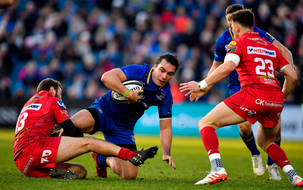 James Lowe of Leinster is tackled by Paul Asquith of Scarlets. Photo by Brendan Moran/Sportsfile