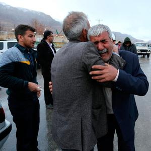 Relatives of passengers who were believed to have been killed in a plane crash react near the town of Semirom, Iran. REUTERS/Tasnim News Agency