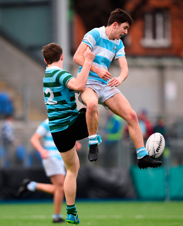 Harry Donnelly of Blackrock College in action against Cormac Foley of St Gerard's School. Photo by David Fitzgerald/Sportsfile