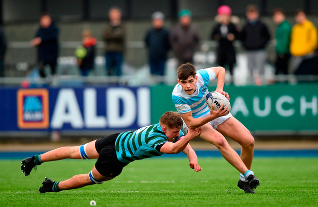 James Tarrant of Blackrock College is tackled by Daniel McGovern of St Gerard's School. Photo by David Fitzgerald/Sportsfile