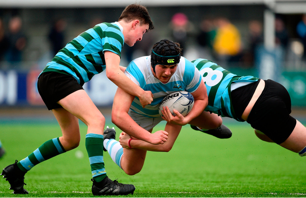 Thomas Clarkson of Blackrock College is tackled by Rory Wilson of St Gerard's School. Photo by David Fitzgerald/Sportsfile