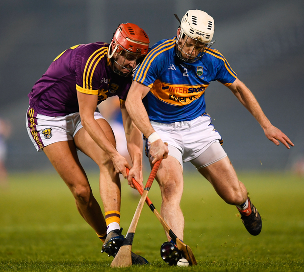 Wexford's Paul Morris and Tipperary's Sean O'Brien battle for possession. Photo: Sportsfile