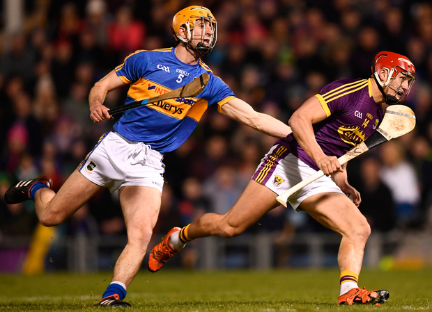 Wexford's Lee Chin is challenged by Tipperary's Barry Heffernan. Photo: Sportsfile