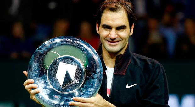Federer breezed past his Bulgarian opponent 6-2 6-2 on the way to his 97th tour-level trophy. Photo: Reuters/Michael Kooren