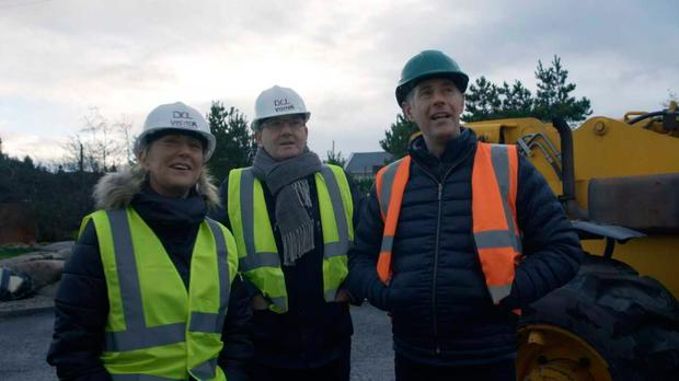 Daniel, Majella and Dermot survey the plans. Pic: RTE / Room to Improve
