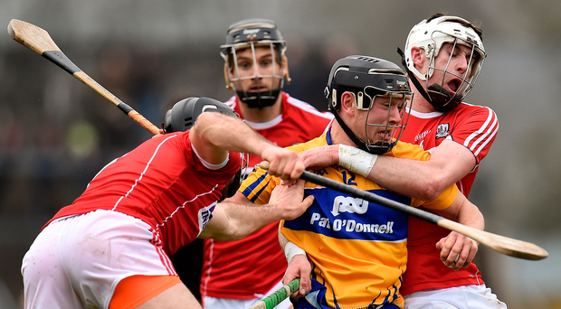 Clare's David Reidy in action against Cork duo Christopher Joyce (left) and Colm Spillane in their Allianz NHL clash. Photo: Sportsfile