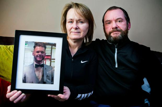 Catherine and Mark Grimes hold a photo of son Callum, who died after being hit by a car. Photo: Kyran O'Brien