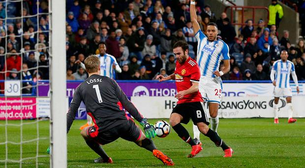 Juan Mata scores the goal that was disallowed. Photo: Reuters/Andrew Yates