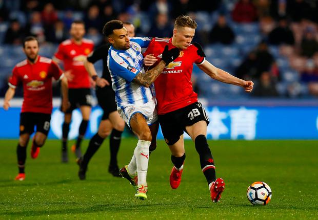 Manchester United's Scott McTominay in action with Huddersfield Town's Danny Williams. Photo: Reuters/Jason Cairnduff