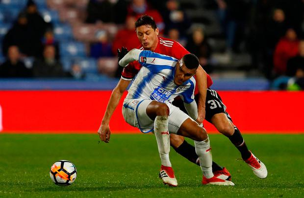 Manchester United's Nemanja Matic in action with Huddersfield Town's Collin Quaner. Photo; Reuters/Jason Cairnduff