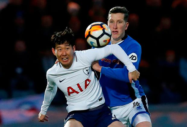 Tottenham's Son Heung-min in action with Rochdale's Jimmy McNulty. Photo: Reuters/Andrew Yates