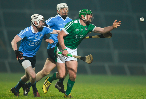 Limerick's Seamus Hickey surges ahead of Dublin's Fionntain MacGibb (left) and Liam Rushe. Photo: Sportsfile