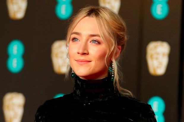 Saoirse Ronan arrives for the British Academy of Film and Television Awards (BAFTA) at the Royal Albert Hall in London. REUTERS/Hannah McKay