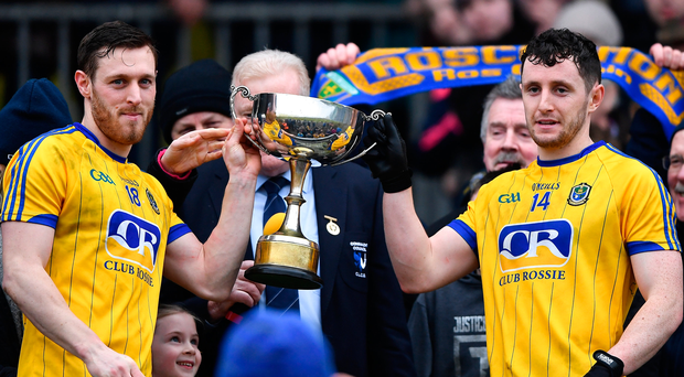 Roscommon's Conor Devaney (left) and Ciarain Murtagh lift the cup. Photo: Sportsfile