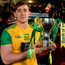 Donegal's Hugh McFadden holds the cup. Photo: Sportsfile