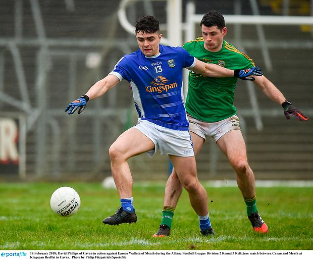 Cavan's David Phillips keeps ahead of Meath's Eamon Wallace. Photo: Sportsfile