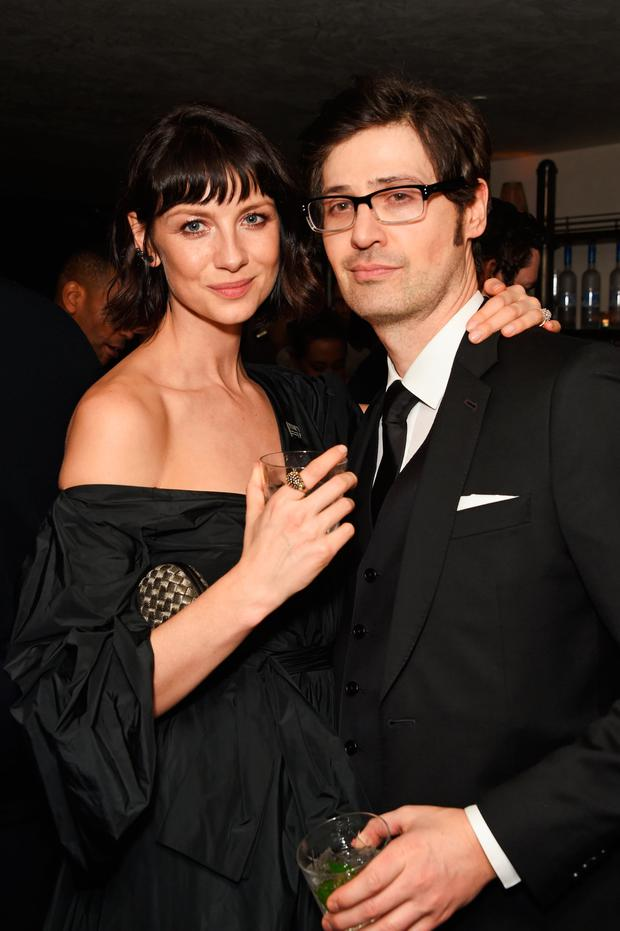Caitriona Balfe (L) and Tony McGill attend the Grey Goose 2018 BAFTA Awards after party on February 18, 2018 in London, England. (Photo by David M. Benett/Dave Benett/Getty Images for Grey Goose Vodka )