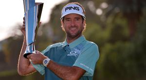 Bubba Watson poses with the championship trophy following the final round of the Genesis Open golf tournament at Riviera Country Club. Orlando Ramirez-USA TODAY Sports