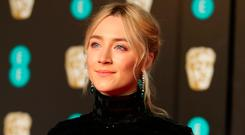 Saoirse Ronan arrives for the British Academy of Film and Television Awards (BAFTA) at the Royal Albert Hall in London, Britain, February 18, 2018. REUTERS/Hannah McKay