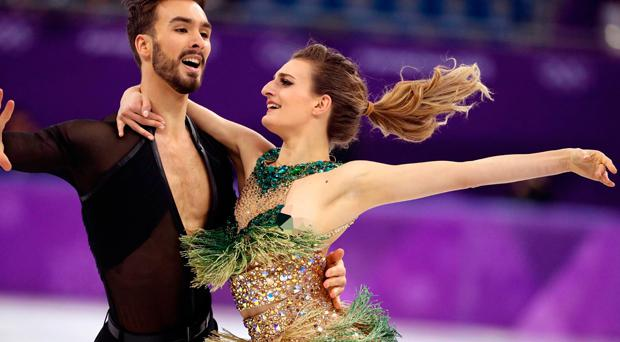 Gabriella Papadakis bravely completed her routine with Guillaume Cizeron after suffering a wardrobe malfunction
